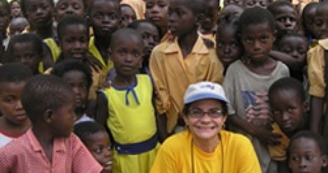 With the children of the village of Adarkwa in Suhum, West Ghana during our concert choir tour 2006